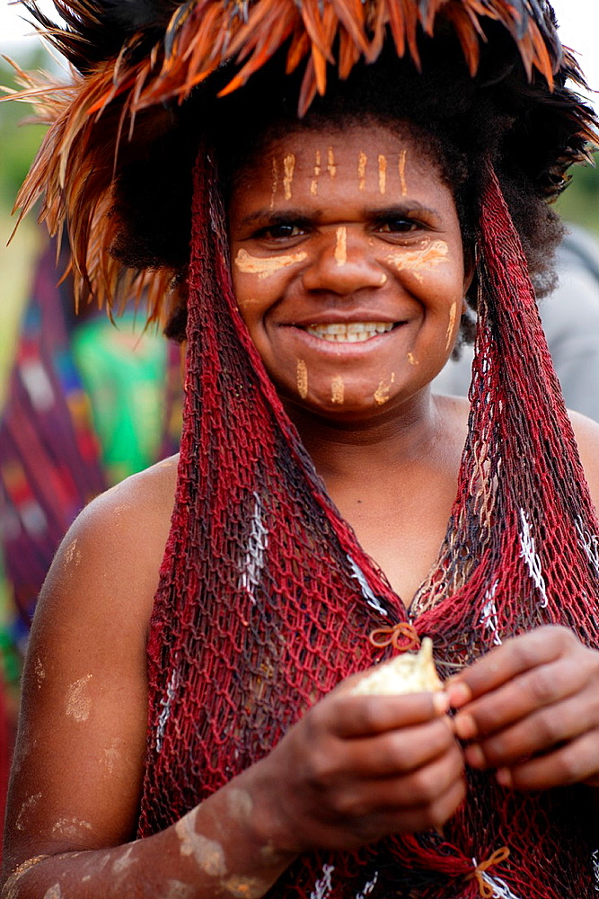 Portrait of local Papuan girl, looking at the camera with traditional face painting, Baliem Valley festival, Jayawijaya region, Papua, Indonesia, Southeast Asian