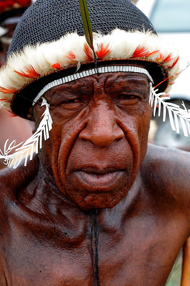 Portrait of old ocal Papuan man, looking at the camera, Baliem Valley festival, Jayawijaya region, Papua, Indonesia, Southeast Asian