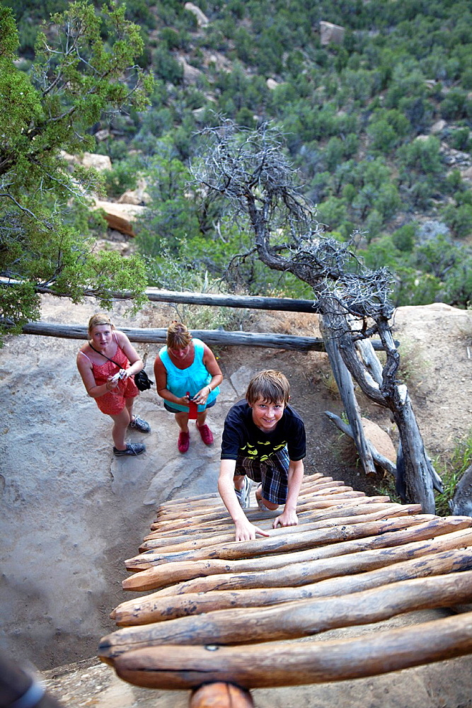 Cortez, Colorado - Visitors climb a ladder as they leave the Balcony House cliff dwelling at Mesa Verde National Park The park features cliff dwellings of ancestral Puebloans that are nearly a thousand years old