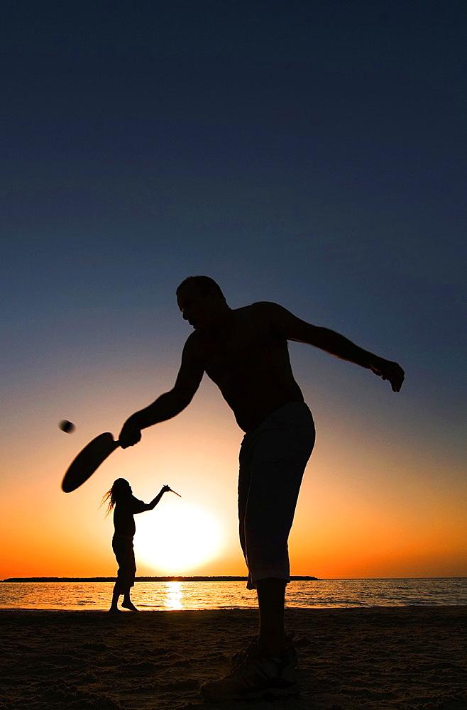 Playing ' Matkot', Israeli beach paddleball, on a beautiful afternoon on the beach of Tel-Aviv.
