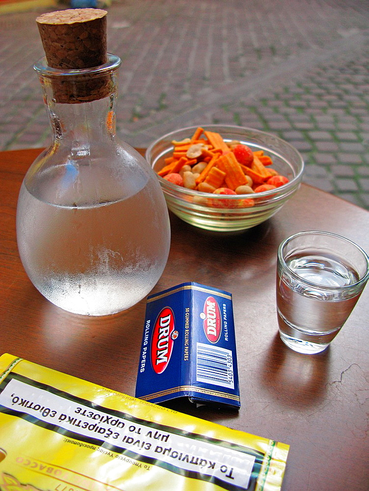 Greek Lifestyle Bottle of Tsikoudia, Packet of Tobacco and Meze, Chania, Crete, Greece