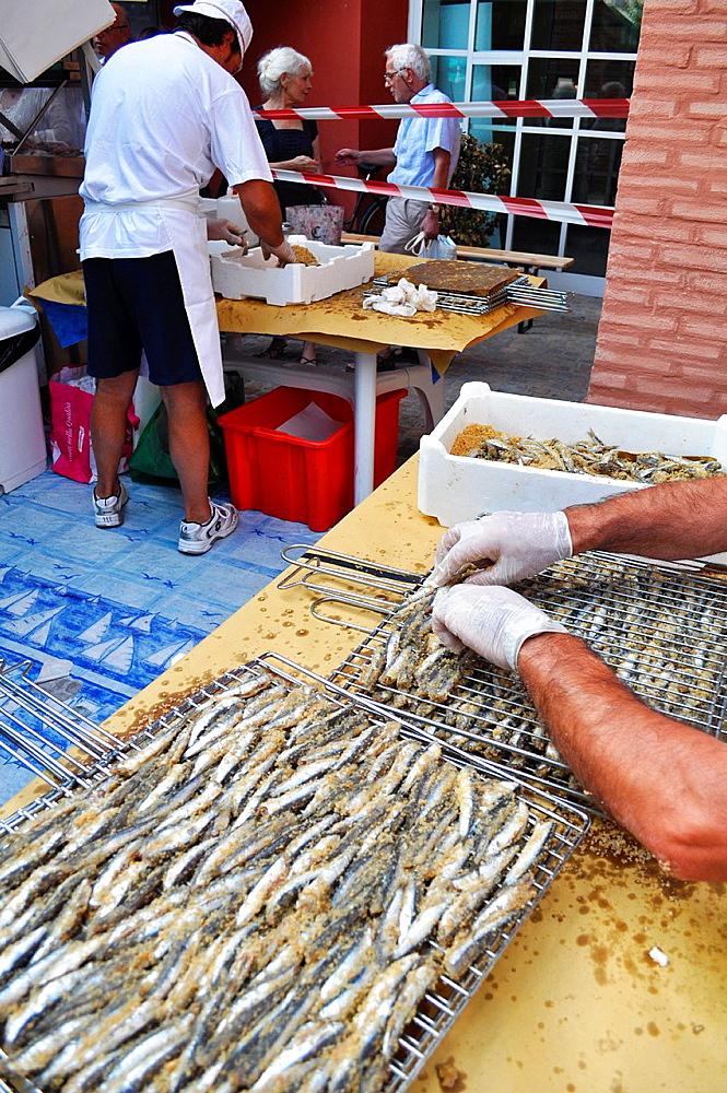 Italy, Bologna, grilled sardines at the Mercato della Terra