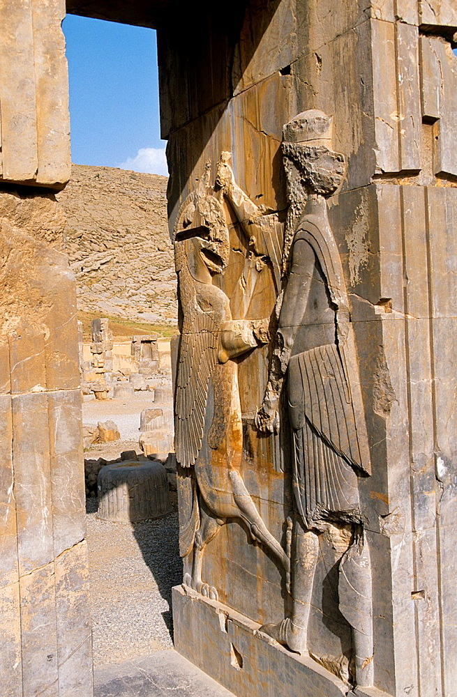 Bas-relief of a fighting warrior and lion at the archaeological site of Persepolis