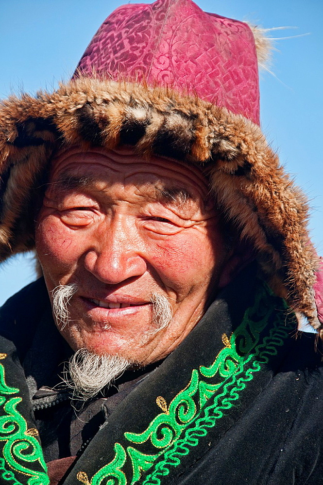 portrait of a Kazakh eagle hunter in the Altai Region of Bayan-Olgii in Western Mongolia