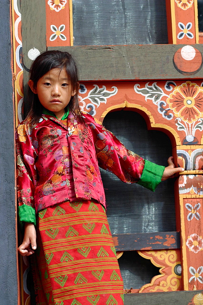 Little girl at the Tsechu festival, Thimphu, Bhutan - 817-369350