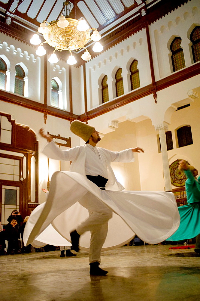 Dervishes dance in Sirkeci train station. City of Istanbul, Turkey