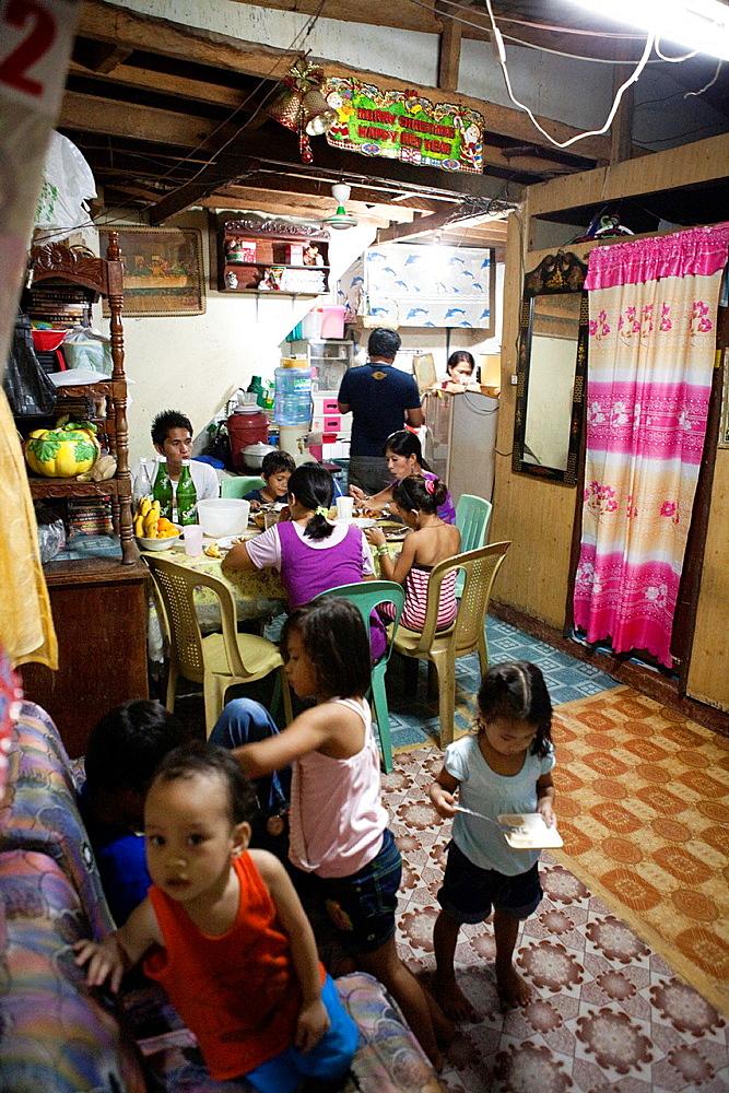 Filipino family having dinner together at home  Lapu-Lapu City, Metro Cebu, Mactan Island, Visayas, Philippines