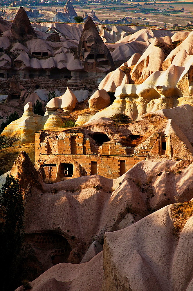 Rock-hewn cave dwellings in cliff. Pigeon Valley, Cappadocia, Anatolia, Turkey