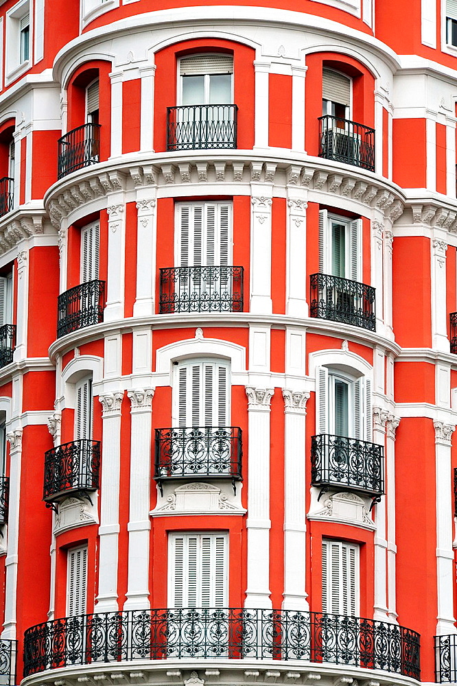 A red and white apartment building in Madrid city, Spain
