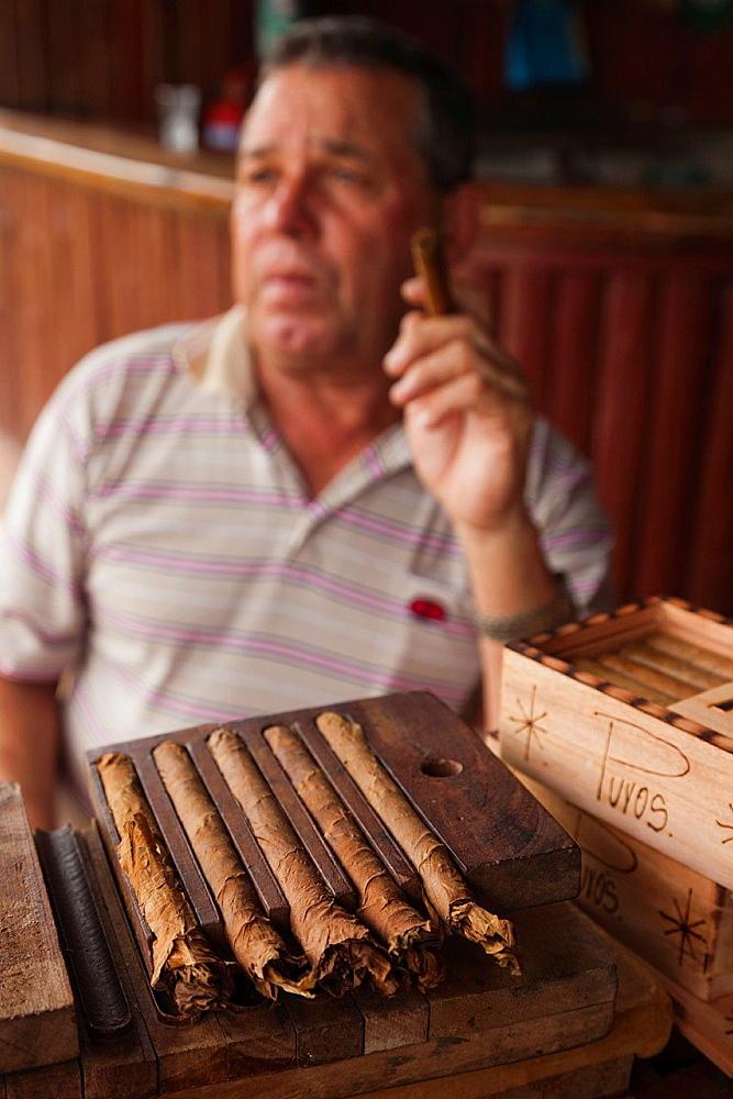 Cuba, Pinar del Rio Province, Vinales, Vinales Valley, tobacco planter smoking Cuban cigar, NR