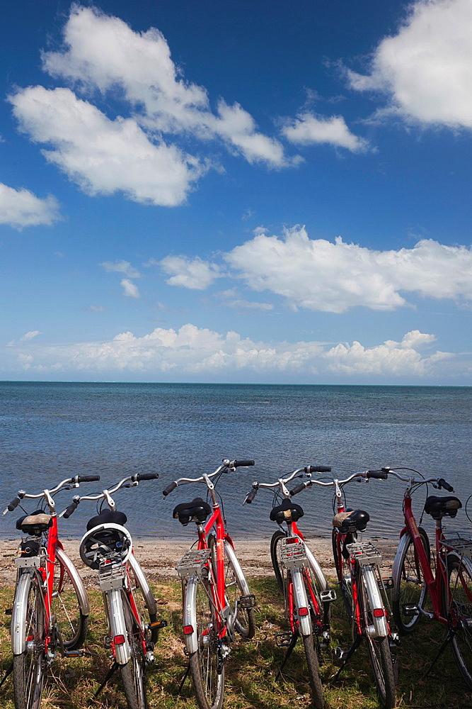 Cuba, Pinar del Rio Province, Puerto Esperanza, bicycles by the seashore