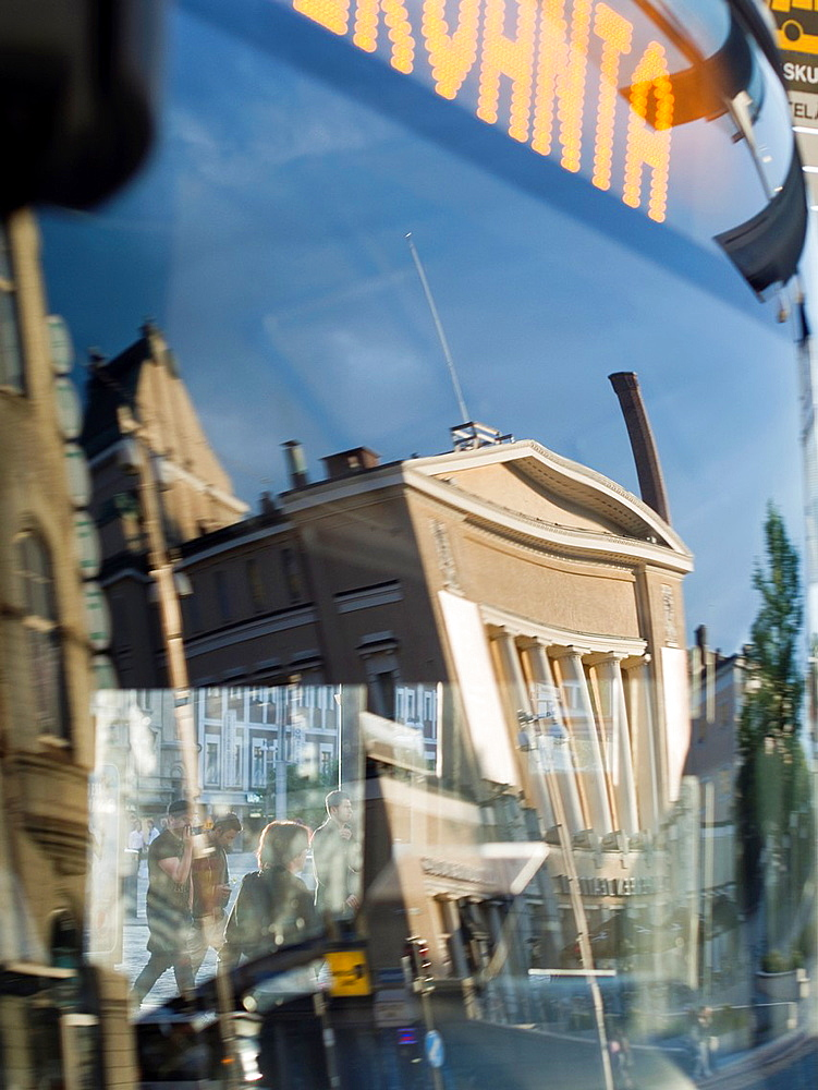 Cityscape reflected in bus window in Tampere, Finland