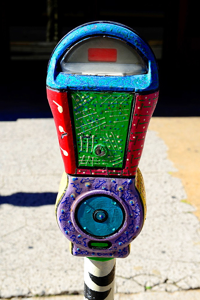 Colorfully decorated parking meter in city parking space