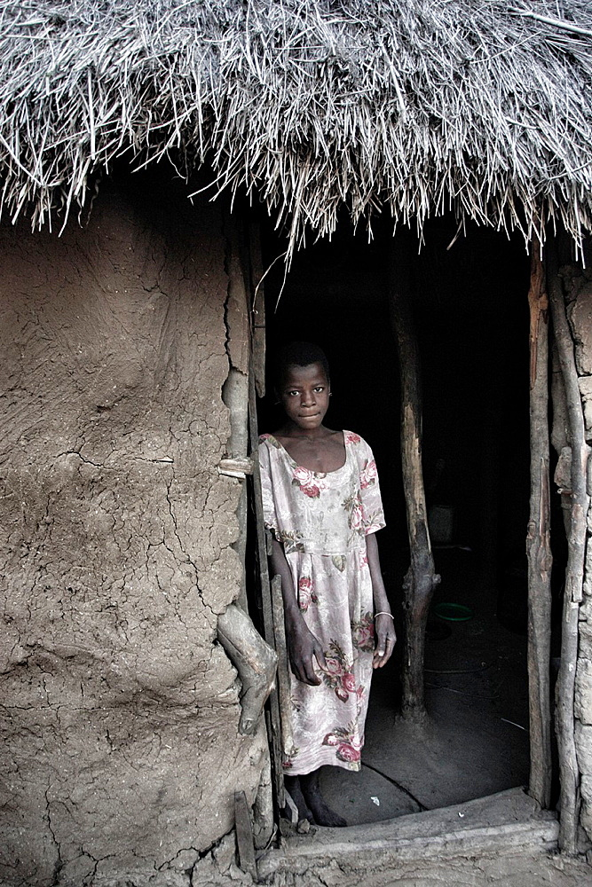 Girl in her house in Chalucuane, Mozambique