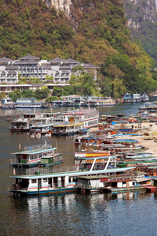 Riverboats in the tourest town of Yangshuo, Guangxi Autonomous Region, China
