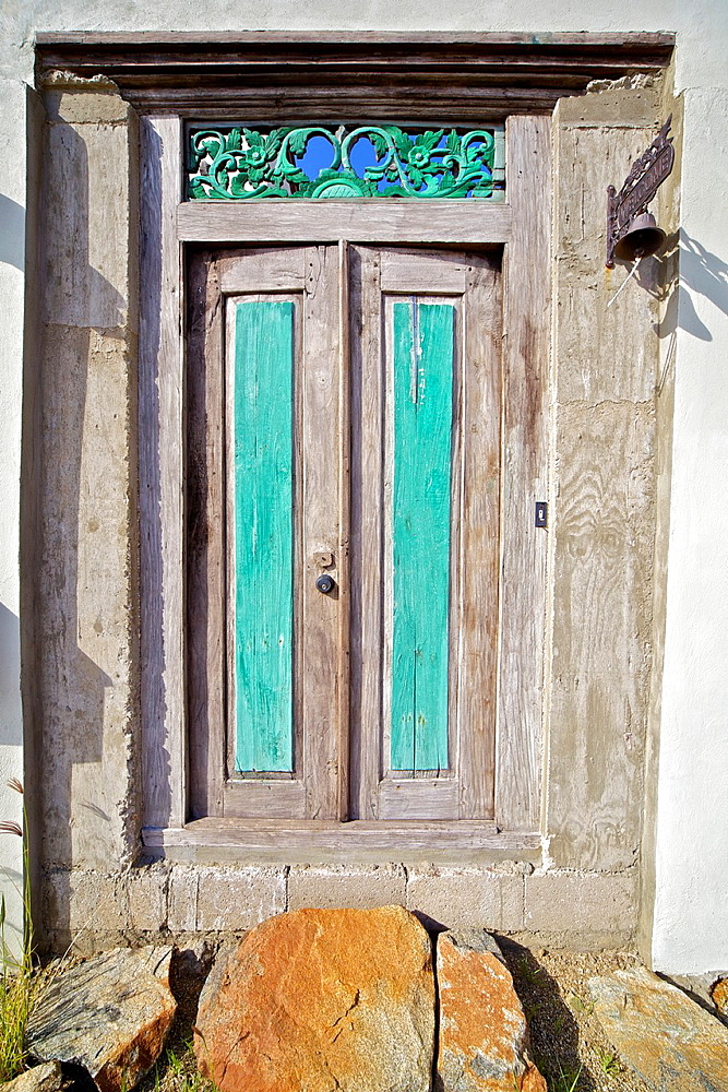 Weathered Wood Door with Green Panels in the Caribbean Island of Aruba