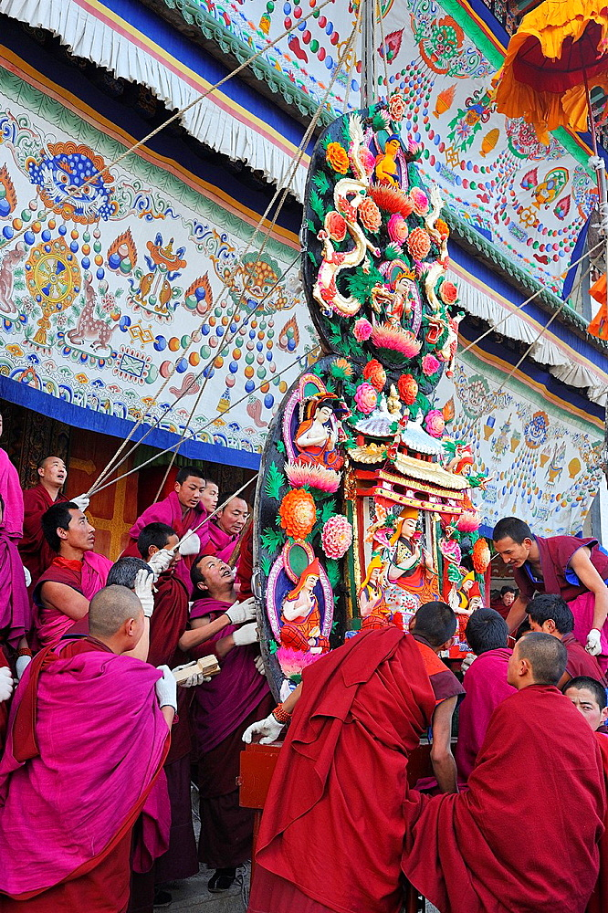 China, Gansu, Amdo, Xiahe, Monastery of Labrang Labuleng Si, Losar New Year festival, Monks setting up skilfully carved yak butter sculptures