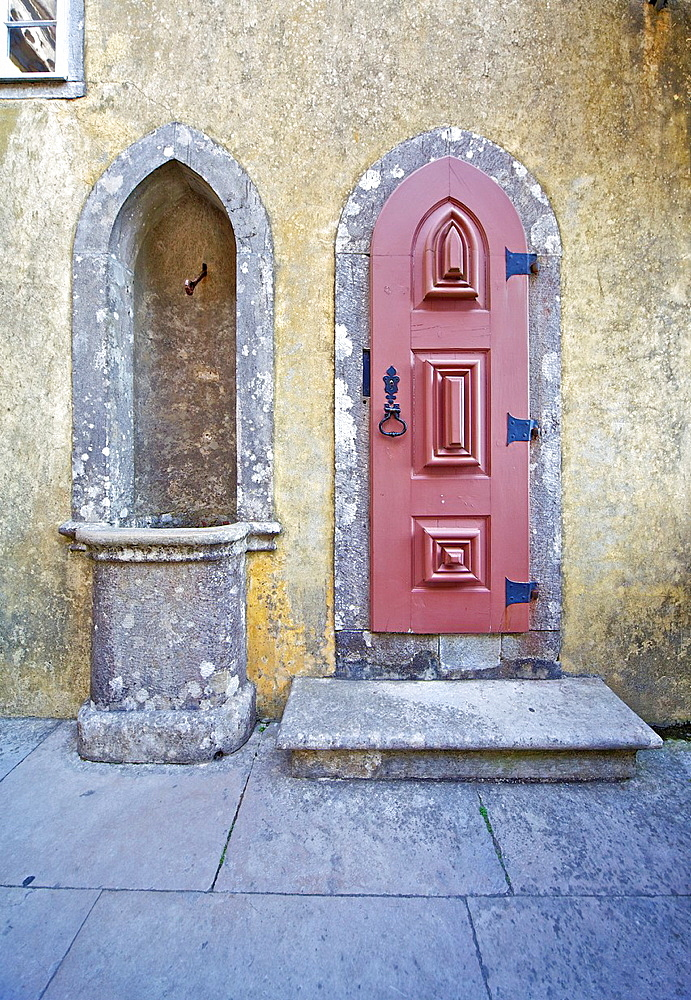 Red Carved Wood Door and a Water Fountain of the Fairytale Castle of Sintra