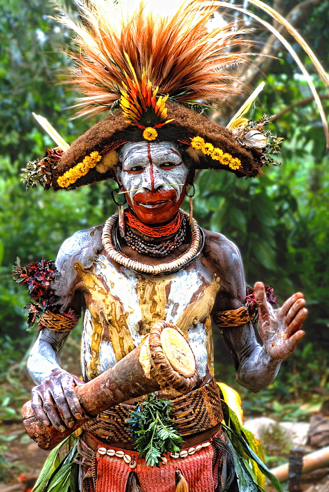 Colorful Huli Wigmen w/ Painted Face In Papua New Guinea