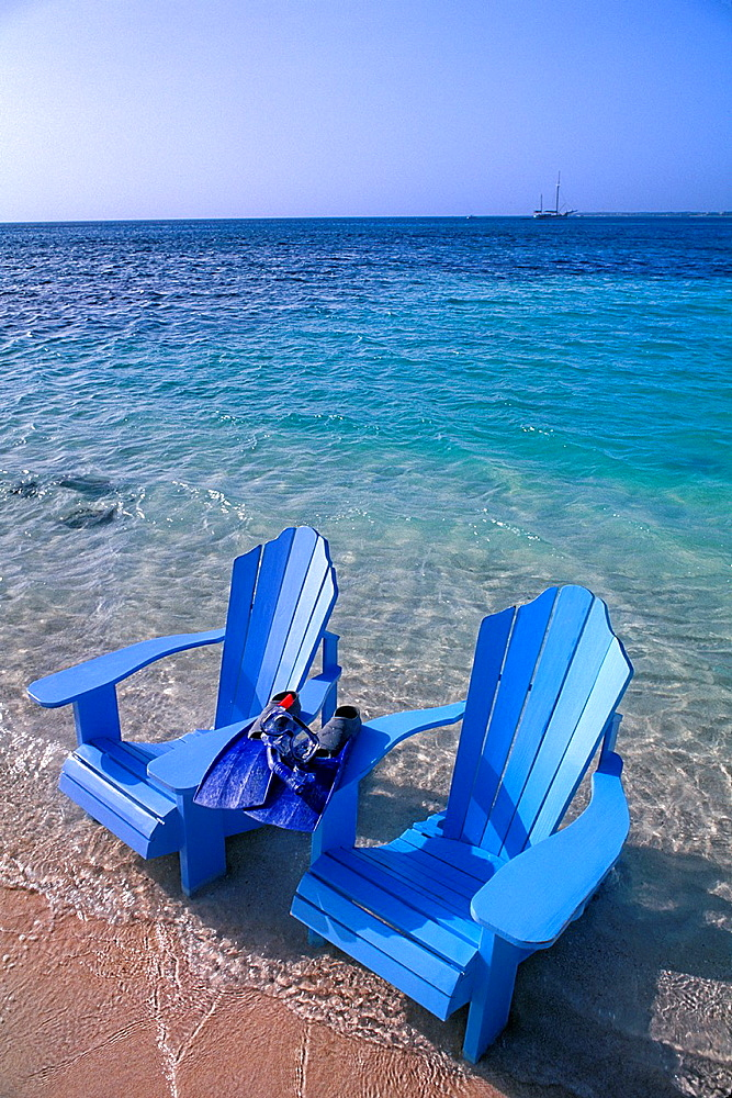 The Perfect Oceanside Caribbean Scene with Chairs in the Water