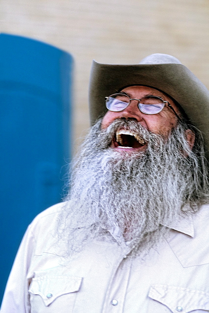 Abstract portrait of laughing cowboy with gray beard in Billings Montana