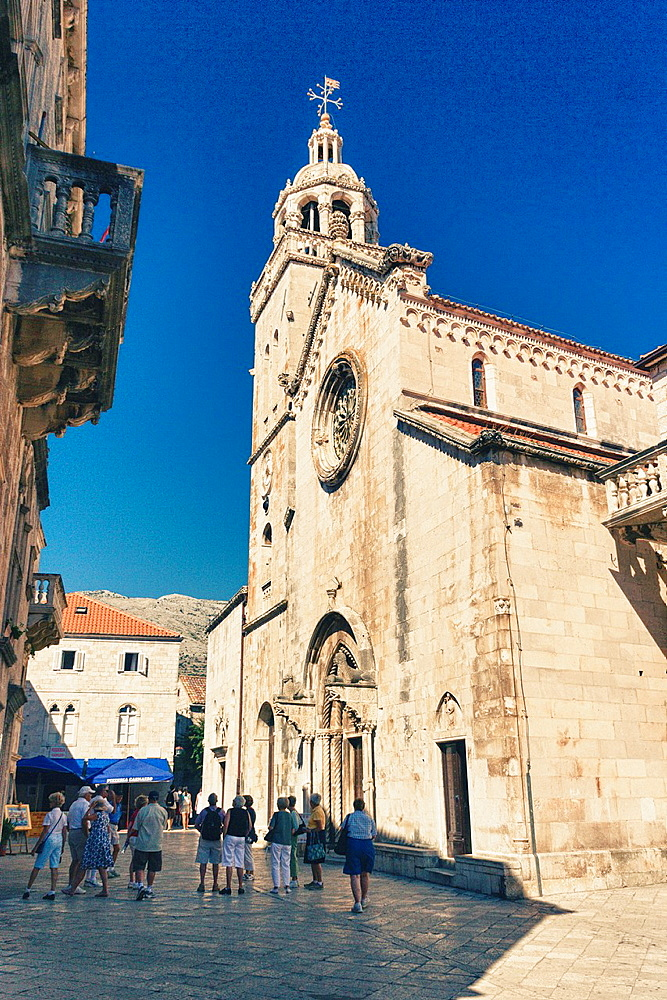Tourists in front of St Mark Cathedral in Korcula old town, Croatia