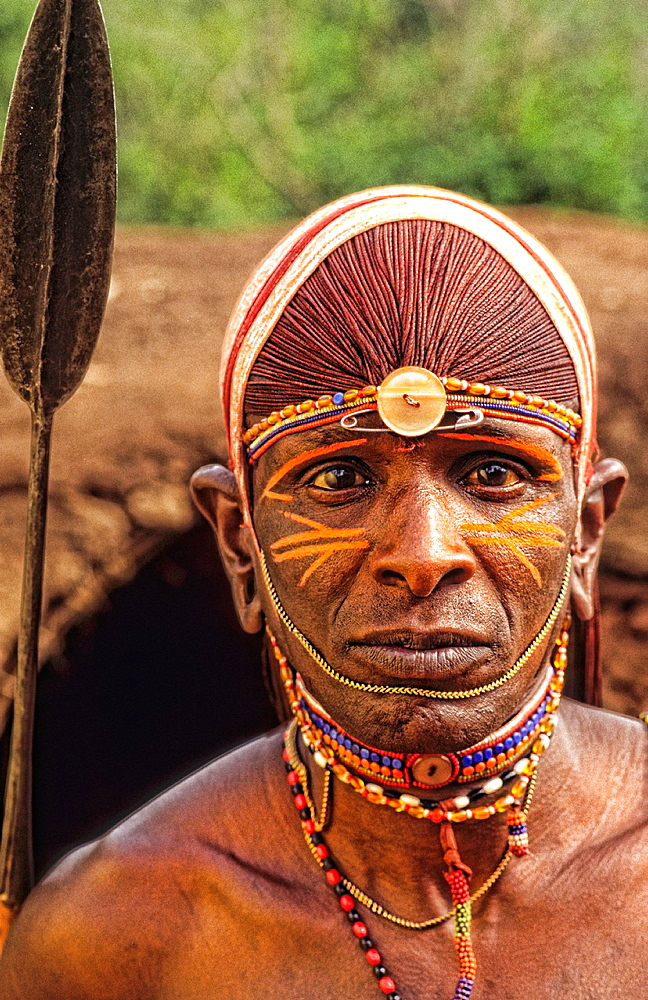 Maasai tribe people in costume traditional dress in jungles in front of hut near Kenya Africa