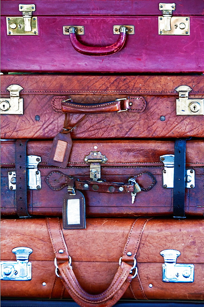 Old Leather Suitcases Laying In A Stock One On Another