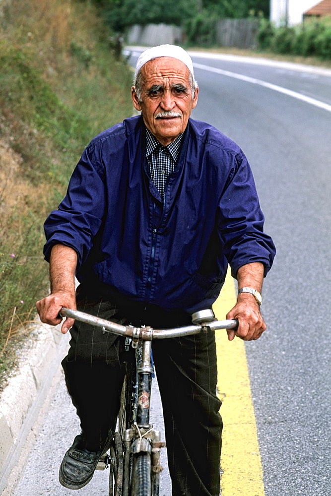 Man on bicycle in Albania near Tirana