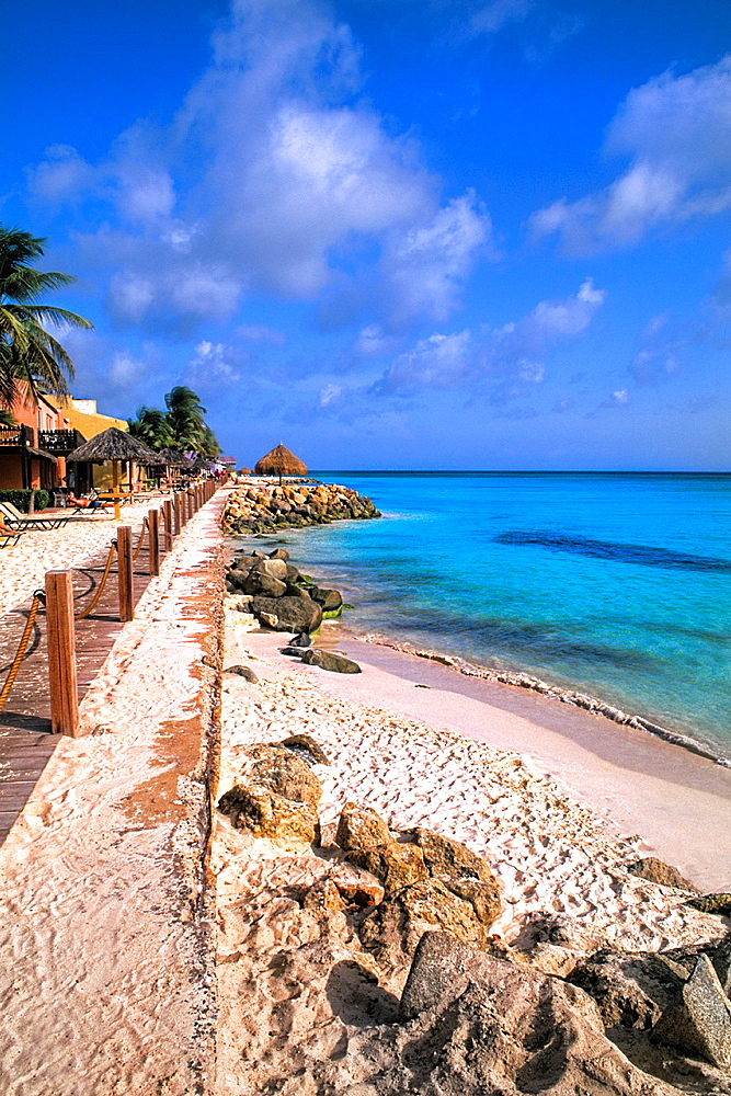 Beach and Rocks of colorful Divi Tamaarian Resort in Aruba
