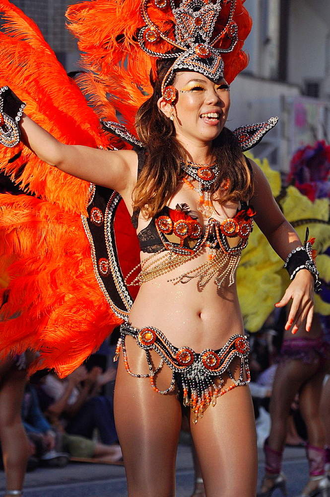 Naha, Okinawa, Japan, Brazilian-style, Japanese samba dancer along Kokusai-dori during the Naha Festival October