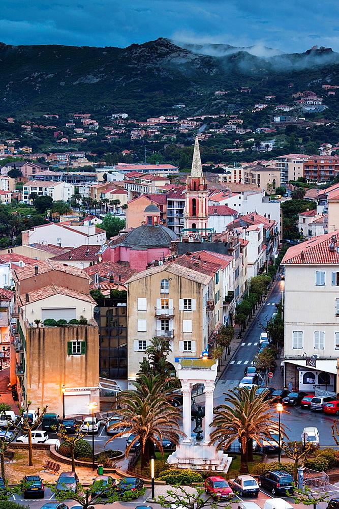 France, Corsica, Haute-Corse Department, La Balagne Region, Calvi, elevated city view above the Place Christophe Colomb, dusk