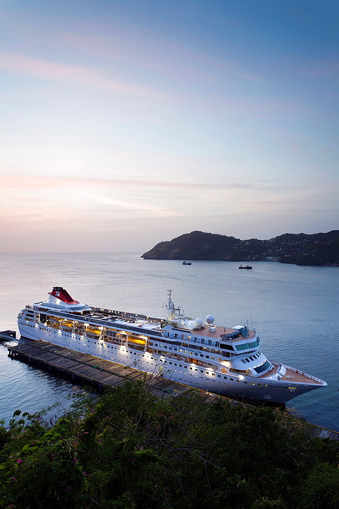 St Vincent and the Grenadines, St Vincent, Kingstown, elevated view of cruiseship, dusk