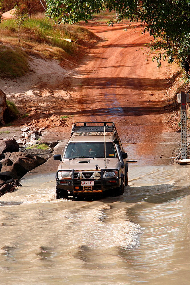 4WD vehicle crossing the East Alligator river at Cahill's crossing Kakadu National Park, Northern Territory, Australia