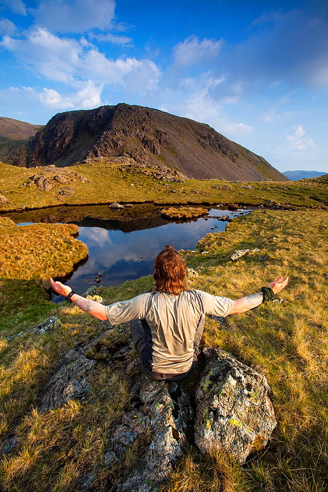 England, Cumbria, Lake District National Park Man in his early 40's admiring the mountain peaks of the north western district of the Lake District National Park