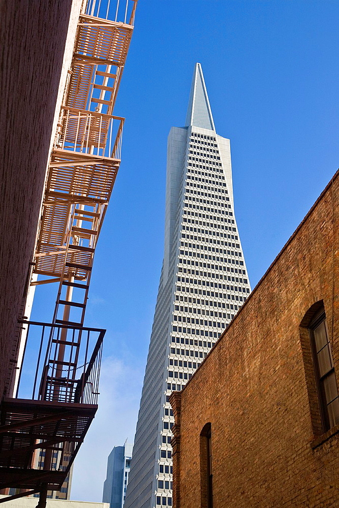 Trans-America pyramid architect: William Pereira and old brick buildings with fire escape, San Francisco, California, USA