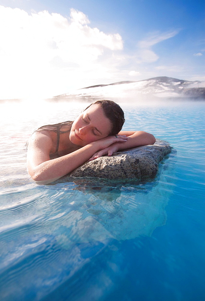 Woman relaxing in thermal lake