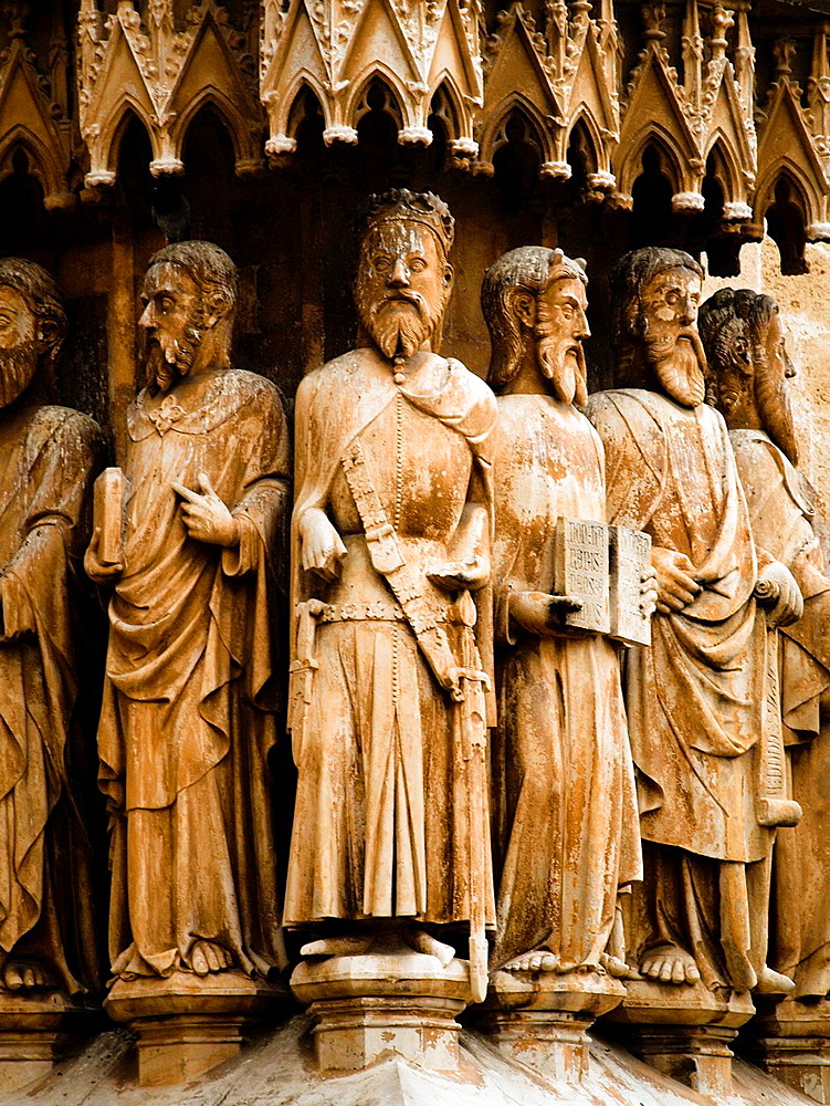 Figures of apostles in the front door of the Cathedral. Tarragona, Catalonia, Spain.