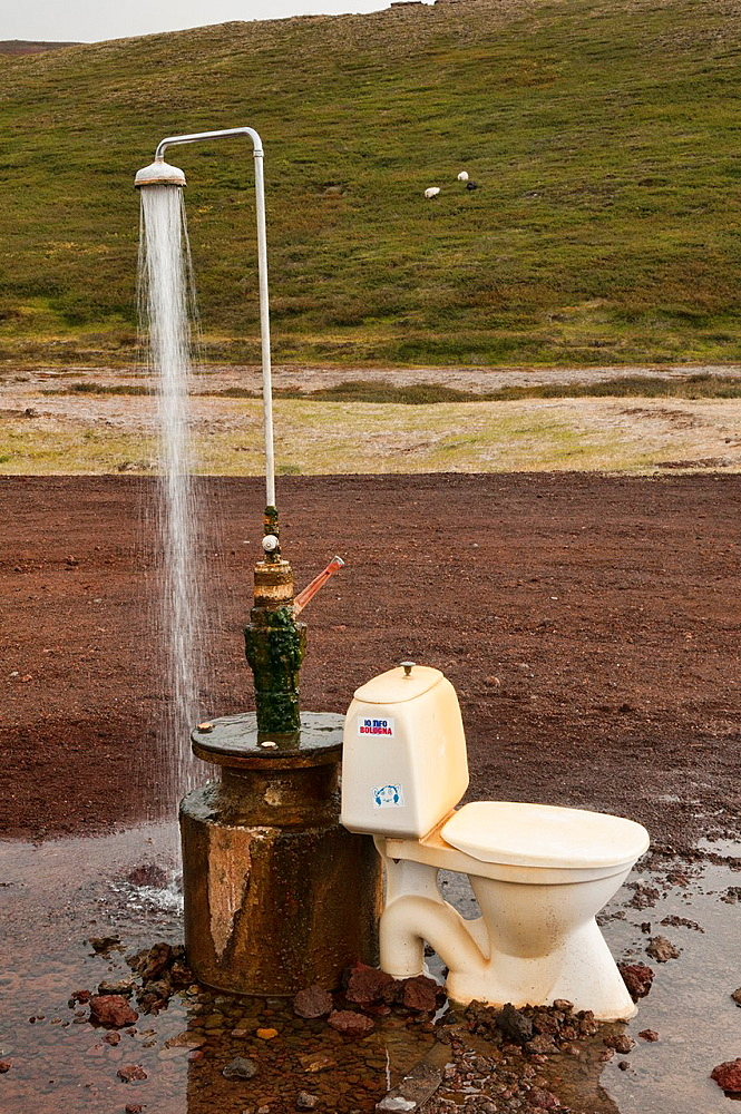 outdoor toilet and hot spring shower from geothermal power at the Krafla volcano near Lake Myvatn, Iceland
