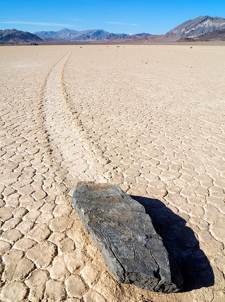 Track created by one of the mysterious moving rocks at the Racetrack The Racetrack is a dry lakebed, a so-called playa, in the remote northern Death Valley Death Valley National Park, California, USA