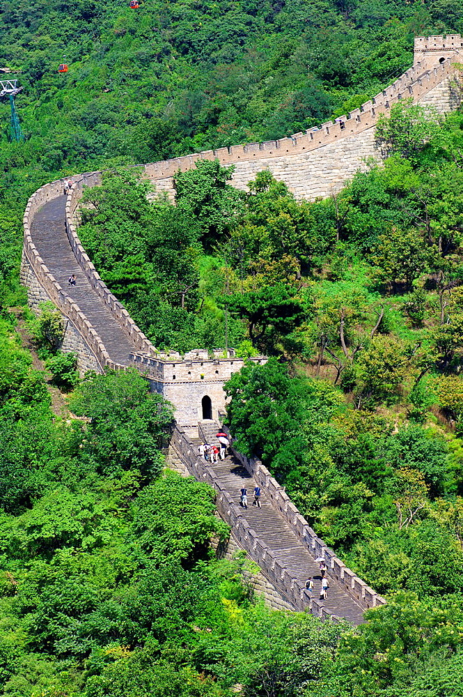 Tourists walk on the Simatai Great Wall of China, Beijing, China