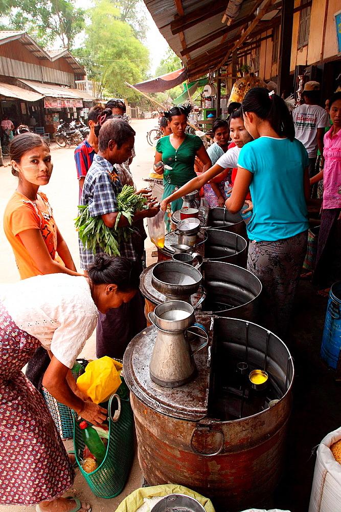 View of the Myinkaba market, cooking oil seller, Old Bagan, Pagan, Burma, Myanmar, Asia