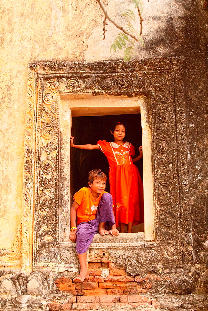 Young Boy and girl Playing near Temple in Bagan, Myanmar, Burma
