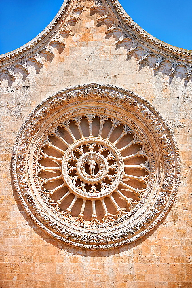 Rose Window on the The Italian Gothic medieval Cathedral of Ostuni built between 1569-1495 Ostuni, The White Town, Puglia, Italy