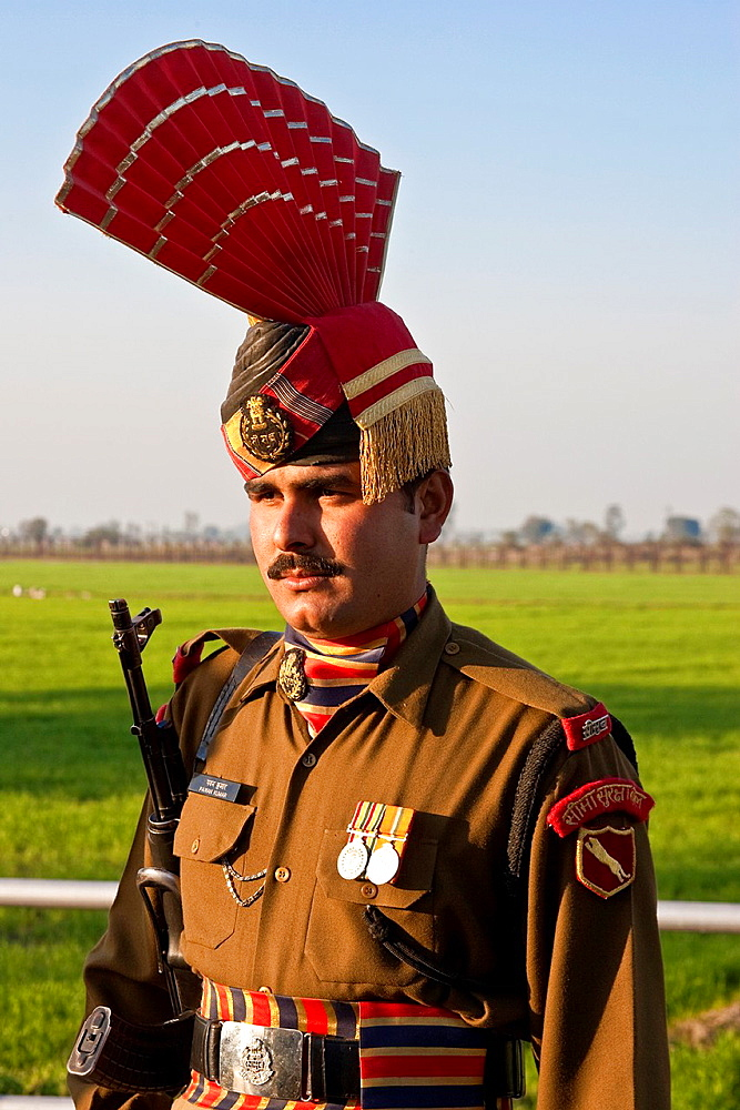 An Indian Soldier in ceremonial dress at the traditional closing of the border ceremony at Wagah, Punjab, India