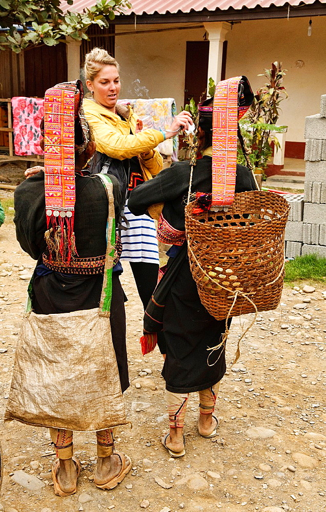 Akha women greeting a tourist, Phongsaly, Laos