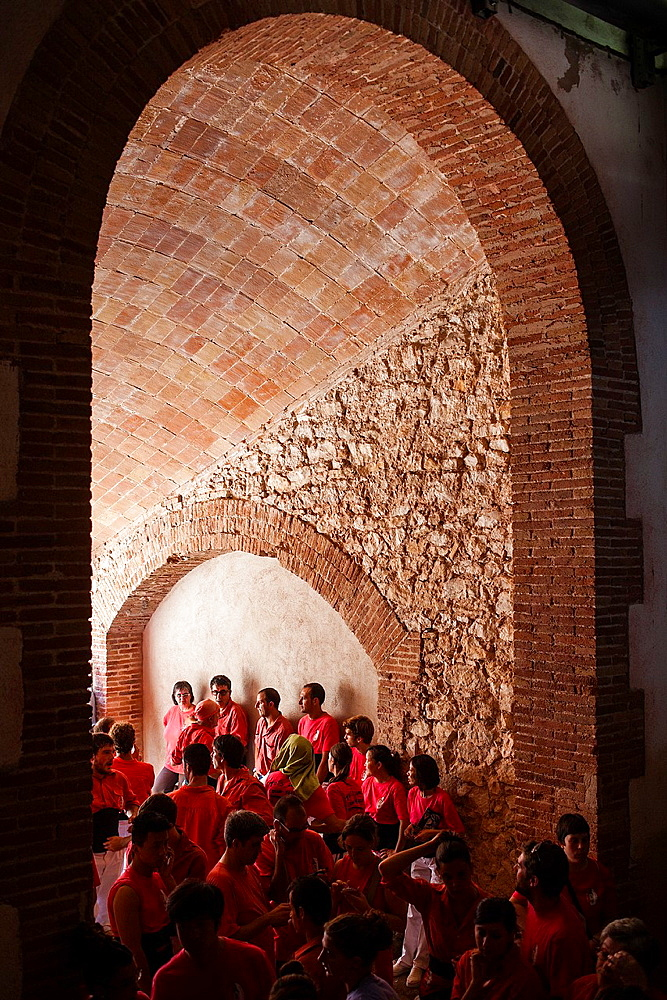 Castellers of Colla Vella Xiquets de Valls resting 'Castellers' building human tower, a Catalan tradition Biannual contest bullring Tarragona, catalonia,Spain