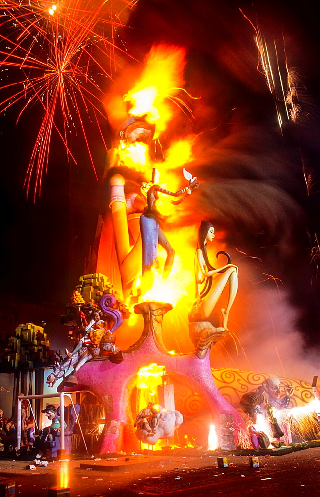 Falla of Plaza del Ayuntamiento burning and fireworks, Fallas festival,Valencia,Spain