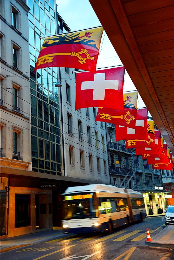 Rue du Rhone at dusk, main commercial street of the city, Geneva, Switzerland