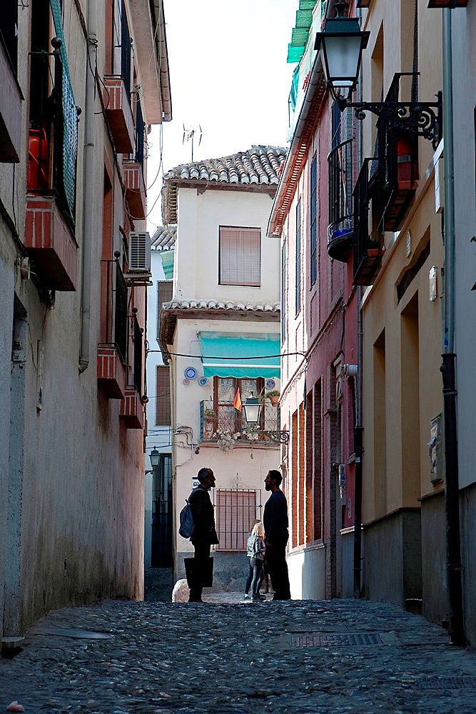 Two Moroccans speaking at the end of street in the Albaicin Granada Spain